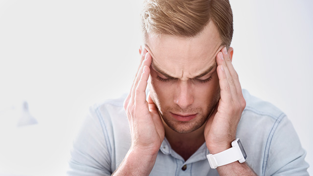stiff-shoulders-headache