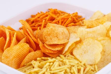 Potato chips in bowl, closeup image.